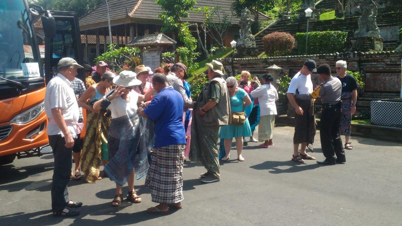 Tourists visit Kehen Temple at Bangli Regency on Sunday.