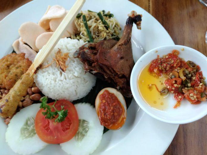 Bebek Bengil's duck menu with Balinese side dishes.