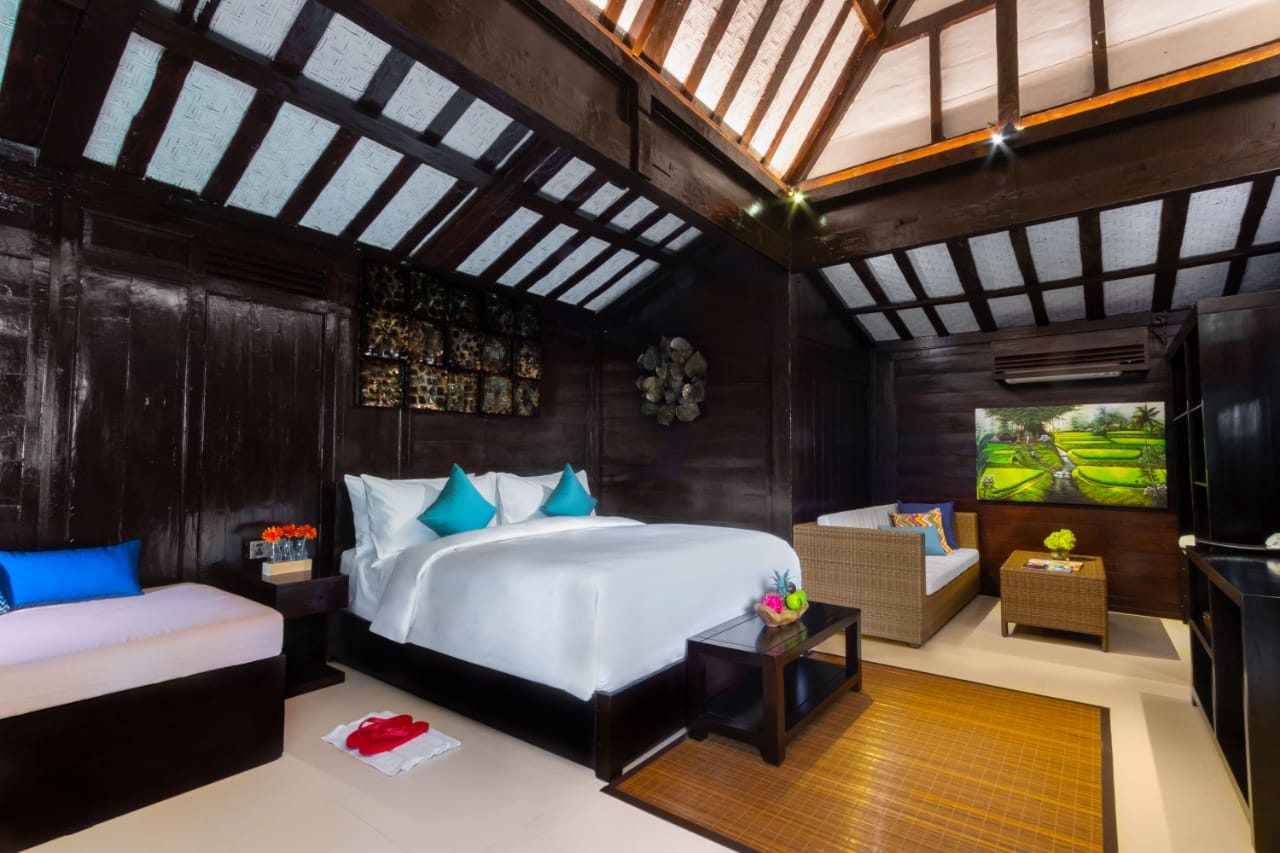 """Deluxe Room with contemporary """"Joglo"""" style at Canvas Escape Ubud."""