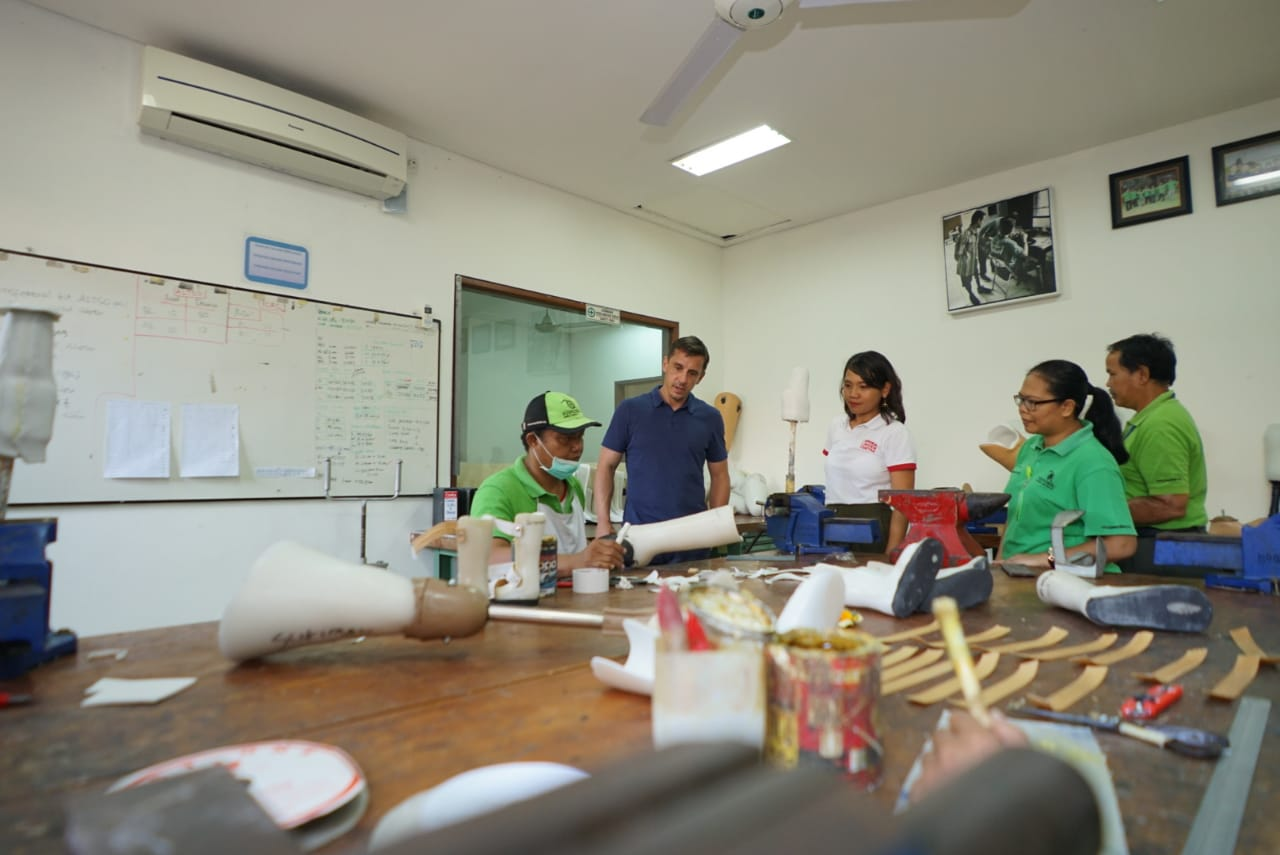 Gary Neville visits the making of prosthetic limbs by the disabled at ALC.