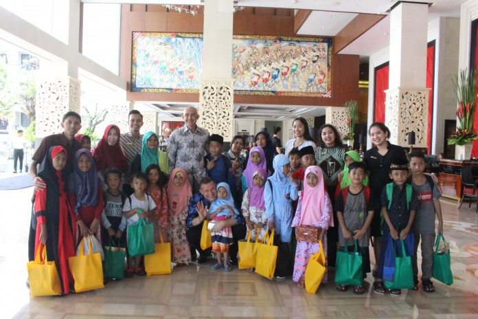 The Trans Resort Bali Management with children from Sakinah Orphanage.